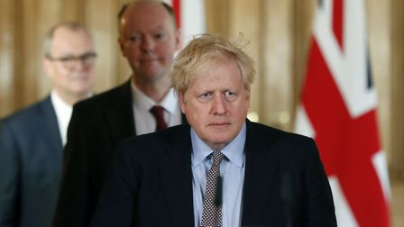 Prime Minister Boris Johnson arrives for a press conference with Chief Medical Officer for England C