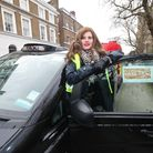 Dr Sharon Raymond, director of Covid Crisis Rescue Foundation, next to a Vaxi Taxi