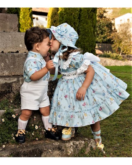 boy and girl in designer clothes