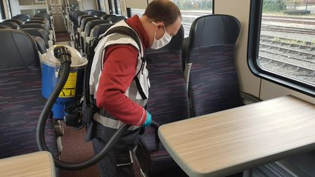 Backpack vacuum cleaner used by Greater Anglia staff