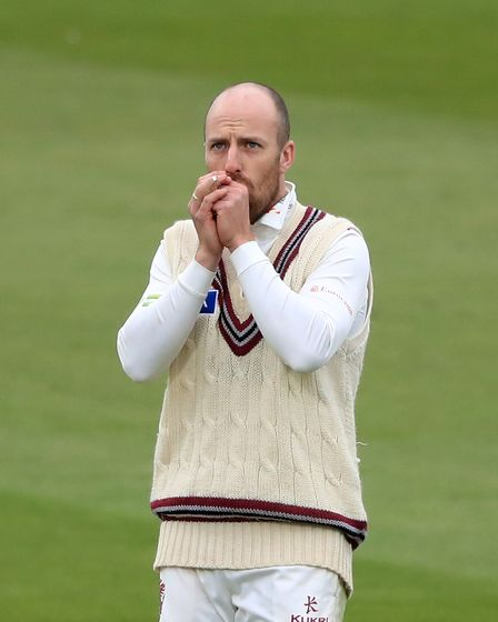 Somerset's Jack Leach feels the cold during the LV= Insurance County Championship match at Lord's