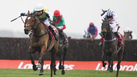 Cloth Cap ridden by Tom Scudamore (white cap) clears the last to win The Ladbrokes Trophy Chase