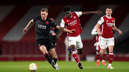 Slavia Praha's Lukas Provod (left) and Arsenal's Thomas Partey battle for the ball during the UEFA E