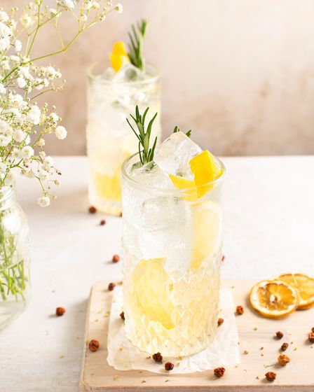 Rosemary gin fizz garnished with sprigs of rosemary