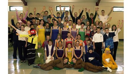 Some of thecast of the 2003Ipswich Gang Show rehearsing a song at the 11th Ipswich Scout HQ in Chesterfield Drive