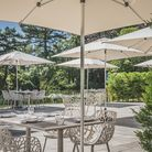 Dine al fresco under parasols