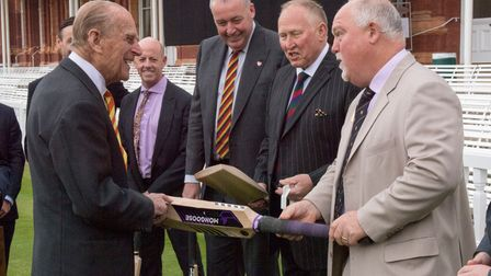 Prince Philip receives a cricket bat from England great Mike Gatting on a visit to Lords in St John's Wood