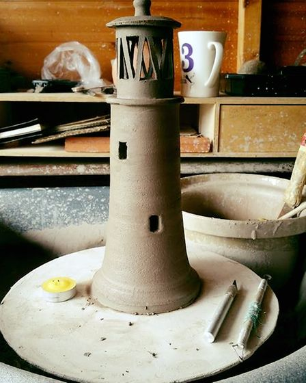 A clay lighthouse before being fired in a kiln.