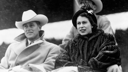 File photo dated 21/10/51 of the then Princess Elizabeth and the Duke of Edinburgh watching a 'stamp