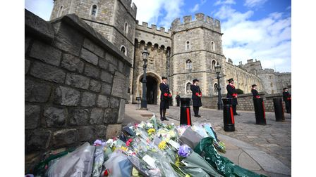 Flowers left outside Windsor Castle, Berkshire, following the announcement of the death of the Duke