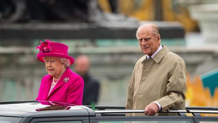 Queen Elizabeth II and the Duke of Edinburgh are driven from Buckingham Palace, in central London