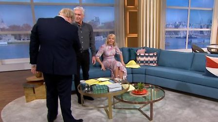 Boris Johnson attempts to shake Phillip Schofield's hand on This Morning. Photograph: ITV.