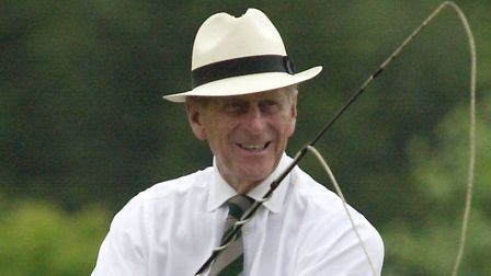 A smiling Duke of Edinburgh competing in the Sandringham Carriage Driving Trials in 2003