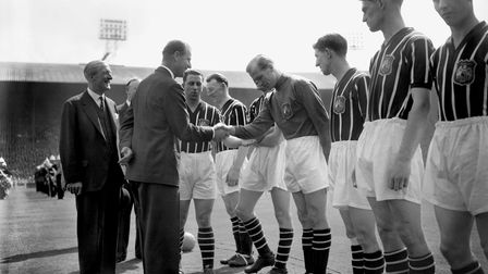 The Duke of Edinburgh shaking hands with Manchester City's Footballer of the Year Bert Trautmann, in Wembley in 1956