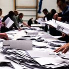 Electoral workers count ballots during elections in Nuuk, Greenland