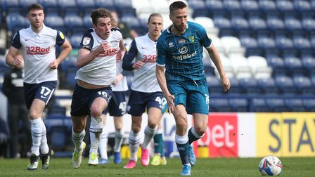 Ryan Ledson of Preston North End and Marco Stiepermann of Norwich in action during the Sky Bet Champ
