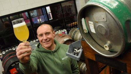 Owner Mark White checks the beer as the Brewery Tap gets ready to reopen on Monday when lockdown res