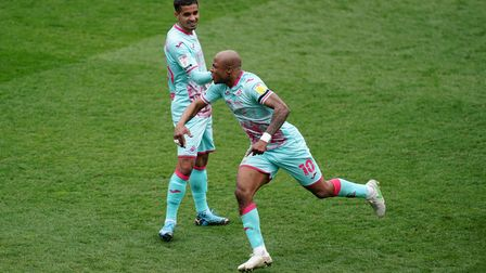 Swansea City's Andre Ayew (right) celebrates scoring their first goal of the game during the Sky Bet