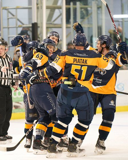 Raiders celebrate a goal away to Bees IHC in the NIHL Spring Cup