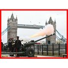 Members of the Honourable Artillery Company fire a 41-round gun salute from the wharf at the Tower of London