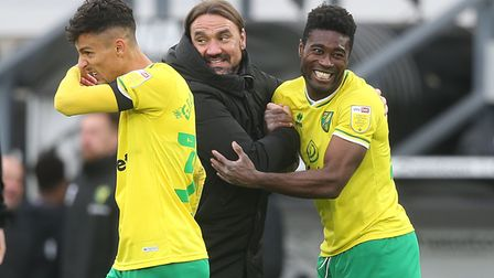 Norwich City head coach Daniel Farke celebrates a 1-0 Championship win over Derby County with Alex Tettey
