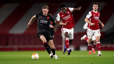 Slavia Prague's Lukas Provod (left) and Arsenal's Thomas Partey battle for the ball at Emirates Stadium