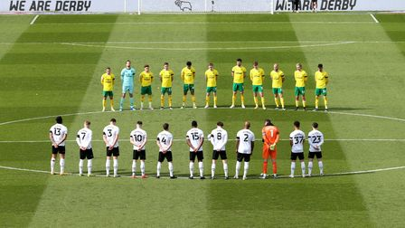 Derby County and Norwich City players stand for a two minute silence prior to kick off, following ye