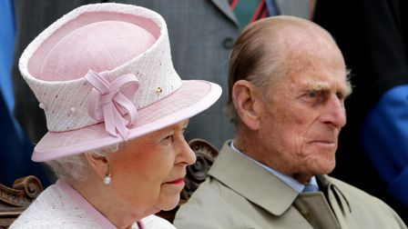 Her Majesty The Queen and HRH The Duke of Edinburgh listen to a speech by The Very Reverend Michael