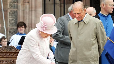 The Duke of Edinburgh watches as Her Majesty The Queen signs a visitor's book at the Cathedral's Wes