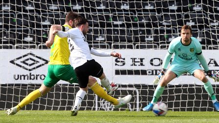 Grant Hanley of Norwich blocks a shot from Patrick Roberts of Derby County during the Sky Bet Champi