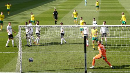Kieran Dowell (pictured far left) whips a superb free kick past Derby County keeper David Marshall to seal Norwich City's win