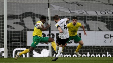 Alexander Tettey of Norwich does enough to make Graeme Shinnie of Derby County blast his shot over t