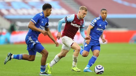 West Ham United's Jarrod Bowen (centre) battles with Leicester City's Wesley Fofana (left) and Youri