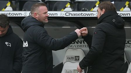 Derby County Manager Wayne Rooney and Norwich Head Coach Daniel Farke at the end of the Sky Bet Cham
