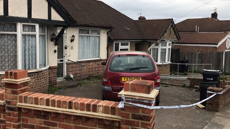 The police cordon outside a bungalow on Rushden Gardens in Ilford, east London, where an elderly lad