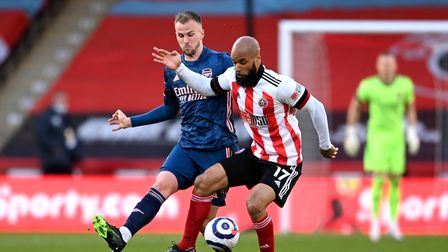 Arsenal's Rob Holding (left) and Sheffield United's David McGoldrick battle for the ball at Bramall Lane