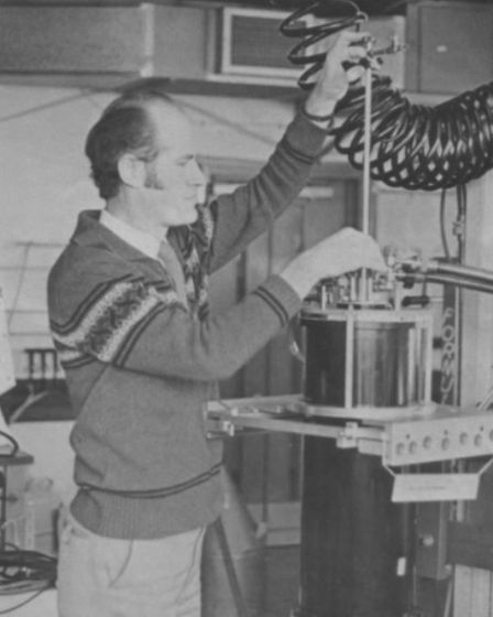 Black and white photo of Andrew Thomson working in the lab