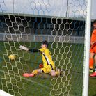 Wellington's goalkeeper scrambles to prevent Clevedon Town's first goal in their friendly