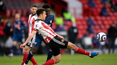 Sheffield United's Ethan Ampadu clears the ball under pressure from Arsenal's Bukayo Saka during the