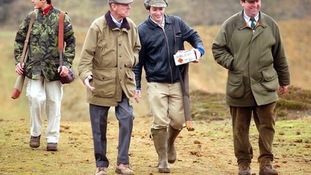 Prince Philip loved shooting. Here he attends the Young Shot competition at Sandringham Shooting school