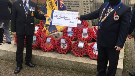 Honiton Lions president Brian Richards, right, presents a cheque to the Royal British Legion's Paul Shaw