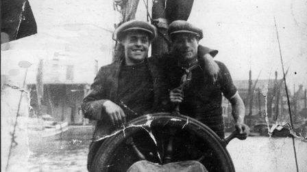 Billy Smith (left) and George Baxter at the wheel of an Ipswich barge