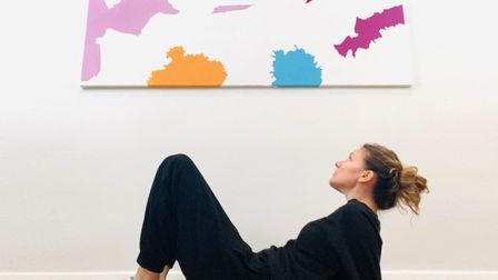 Artist Lucy Jagger with one of her post lockdown paintings titled Santorini