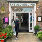 Team member Shannon from The Old Bull Inn in Royston ready to welcome back customers.