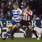 Dave Kitson (left) battles with Sunderland's Michael Chopra while playing for Reading in 2007