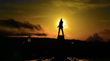 A dramatic sunset over the statue of Lord Carson, outside Northern Ireland's Stormont building