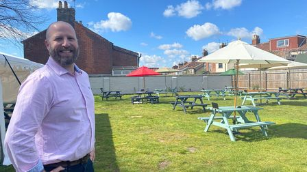 Landlord Andrew McNeil in the pub garden at The York.