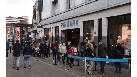 A queue of shoppers form outside Primark in Romford