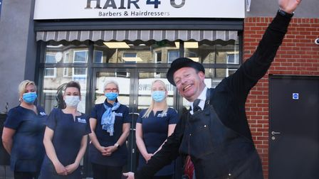 Mark Roberts owner of Hair 4 U in Great Yarmouth, celebrates opening his hair salon with his staff,