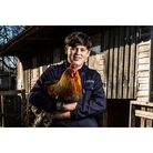 Animal care student holding chicken